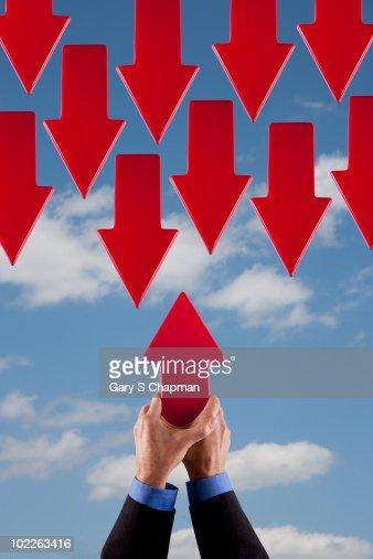 Businessman with single arrow against many arrows : Stock Photo
