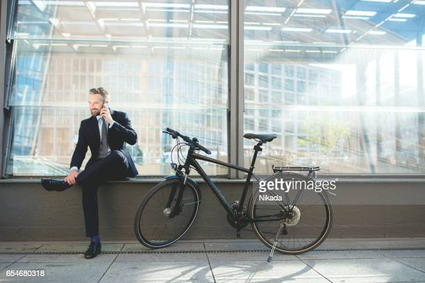 Businessman with Smart Phone and bike