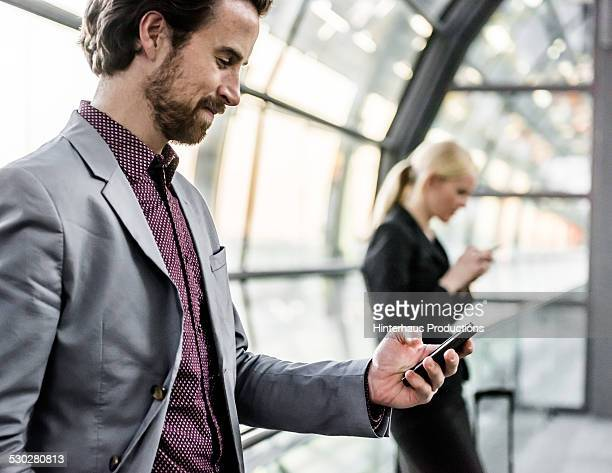 Businessman With Smart Phone At Airport