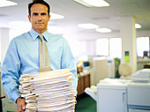 Businessman with stack of papers