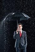 Businessman with Sturdy Umbrella