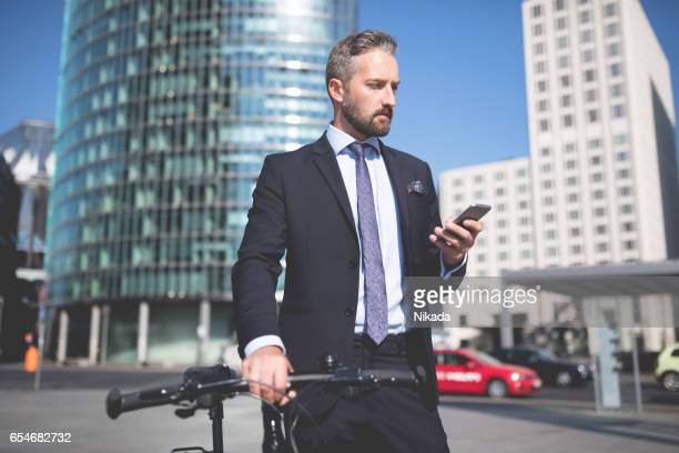Businessman with Suitcase and Smart Phone