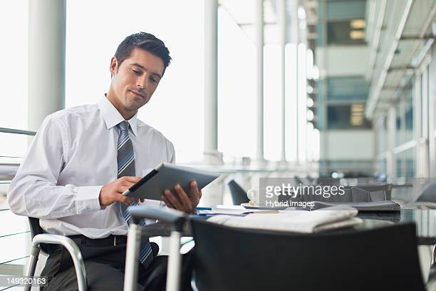 Businessman with tablet computer in cafe