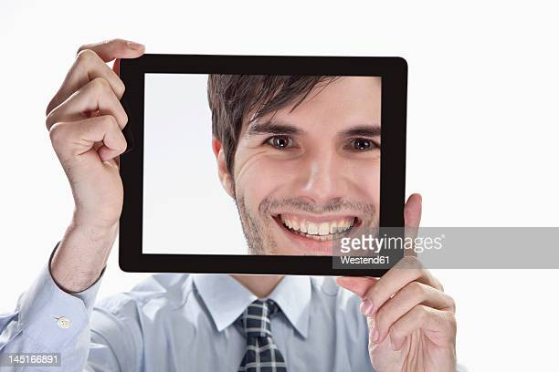 Businessman with tablet pc, portrait