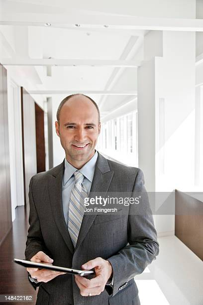 Businessman with tablet smiling