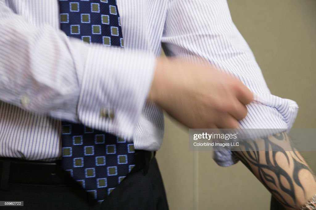 Businessman with tattoo : Stock Photo