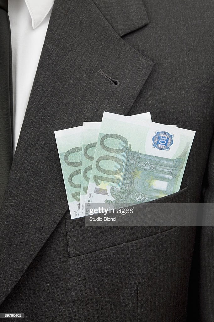 A businessman with three one hundred Euro bills in his breast pocket