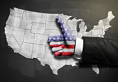 Businessman with thumbs map with USA flag over USA map on blackboard / Flag concept (Click for more)