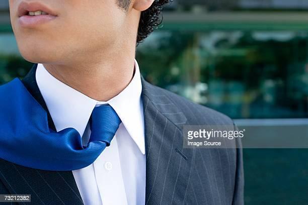 Businessman with tie on shoulder