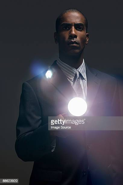 Businessman with torch