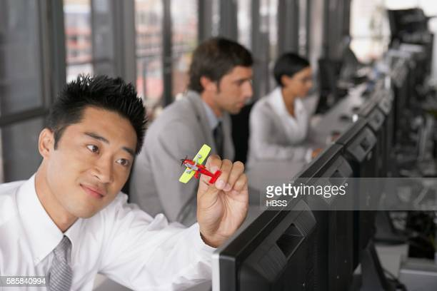 Businessman with toy airplane