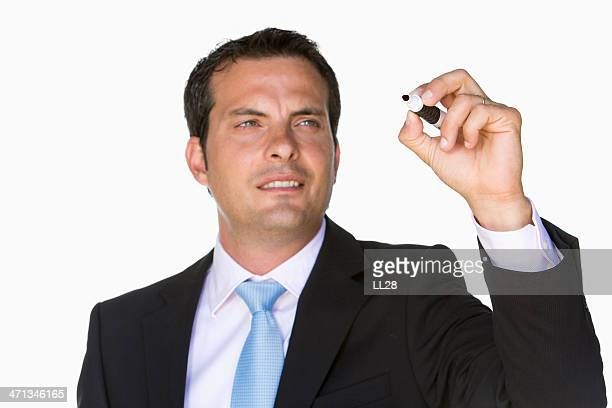 Businessman with white board pen
