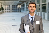 Businessman with white copy space on his name tag.
