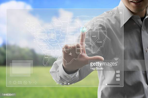 Businessman with world on screen