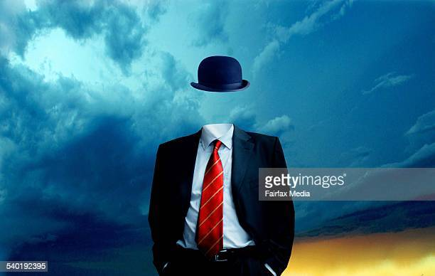 Businessman without head against sky