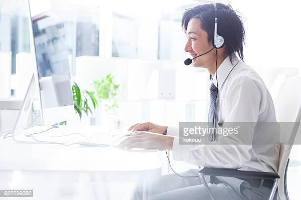 Businessman working at a call center