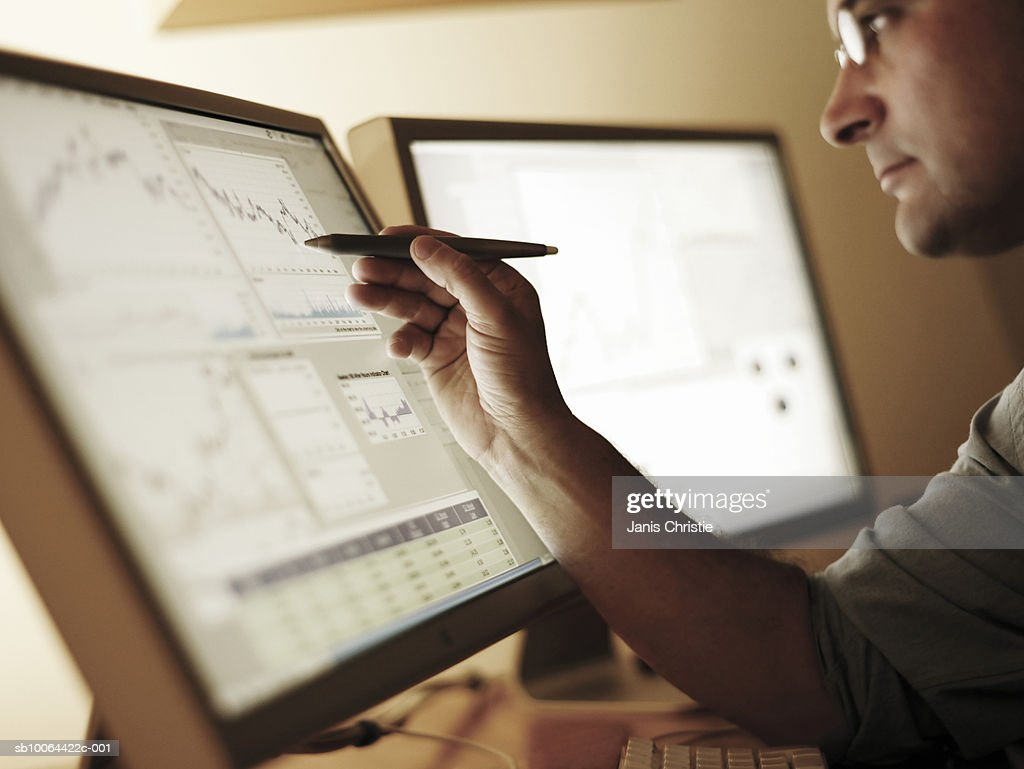 Businessman working at computer screen (differential focus) : Stock Photo