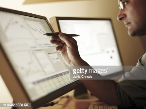 Businessman working at computer screen (differential focus) : Bildbanksbilder