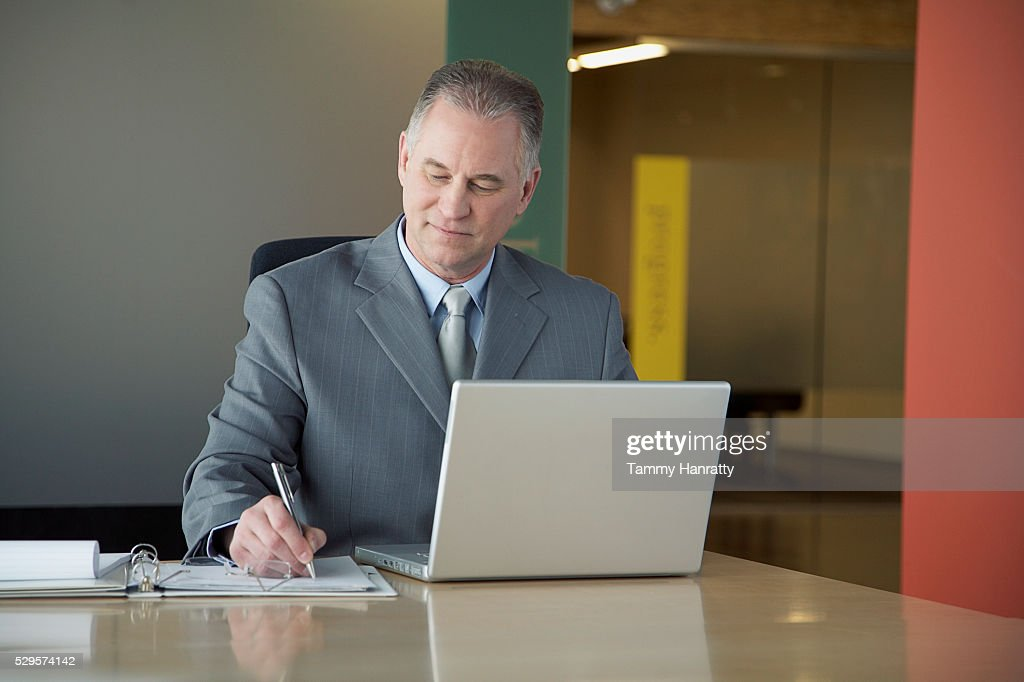 Businessman working at desk : ストックフォト