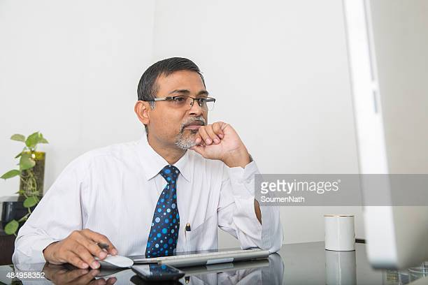 businessman working at his desk and thinking