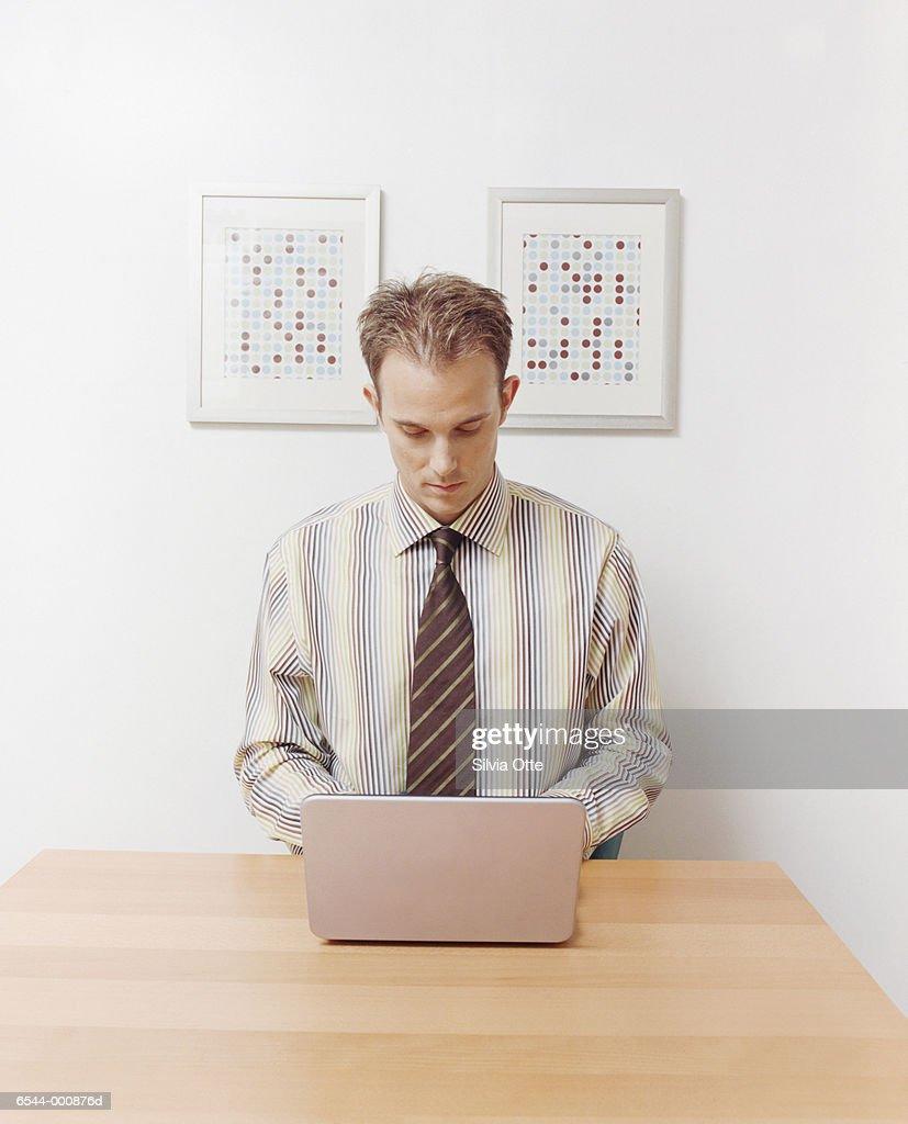 Businessman Working at Laptop : Stock Photo