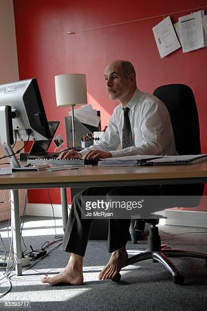 businessman working barefeet in office