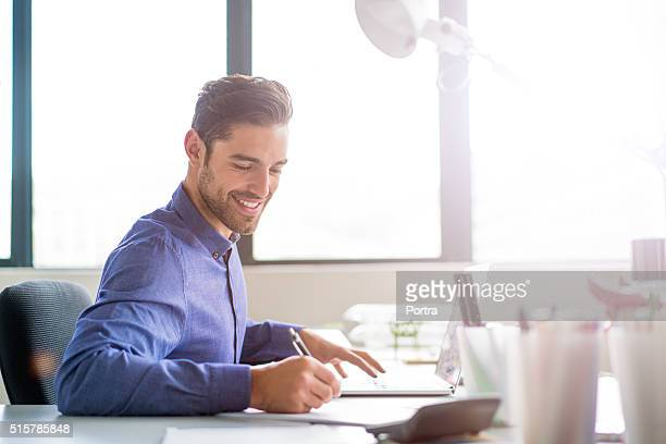 Businessman working in brightly lit office