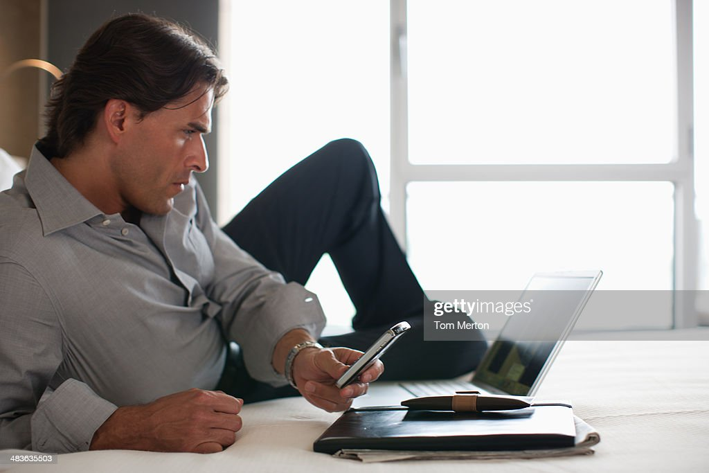 Businessman working in hotel room : Stock Photo