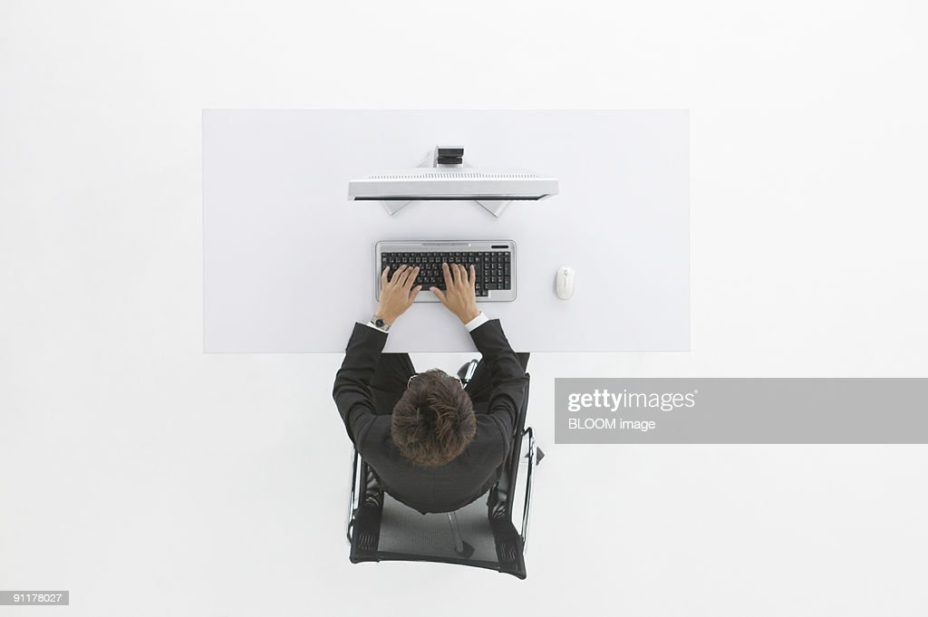 Businessman working in office, view from above, studio shot : Stock Photo