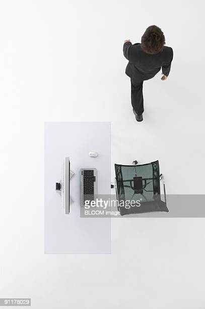 Businessman working in office, view from above, studio shot