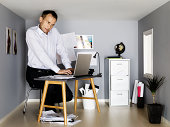 Businessman working in small room