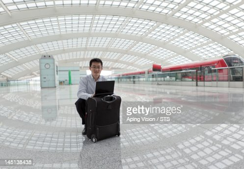 businessman working in the airport while traveling