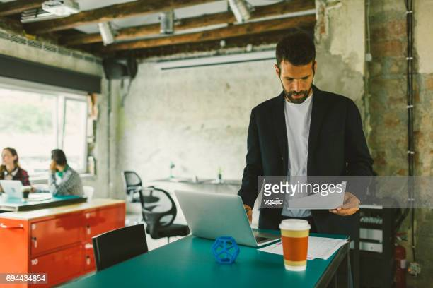 Businessman working in the open space office