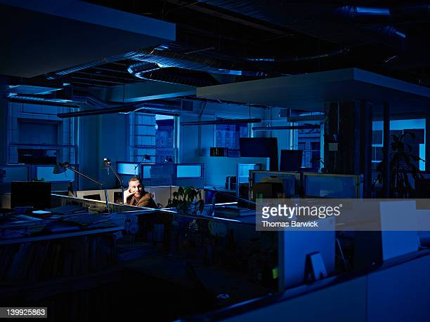 Businessman working late at desk in office