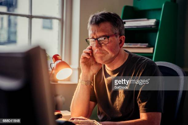 Businessman Working Late at Home