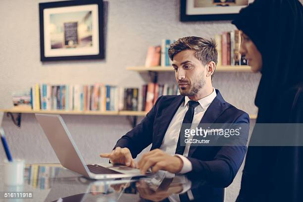 Businessman working on a business model with an Arab colleague.