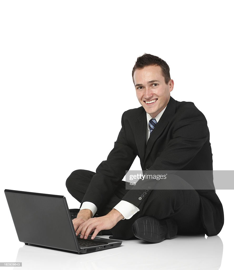 Businessman working on a laptop : Stock Photo