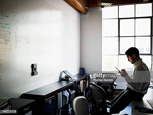 Businessman working on digital tablet in office
