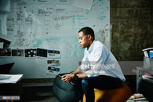 Businessman working on digital tablet in office : Stock Photo