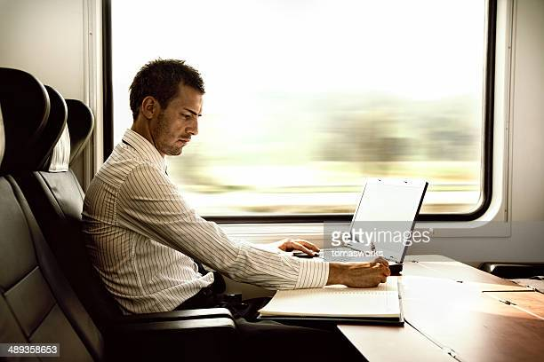 businessman working on high speed train