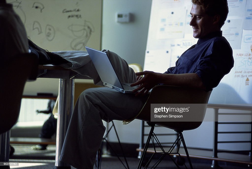 Businessman working on laptop at conference table : Stock Photo