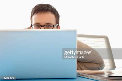 Businessman working on laptop at desk in office : Stock Photo