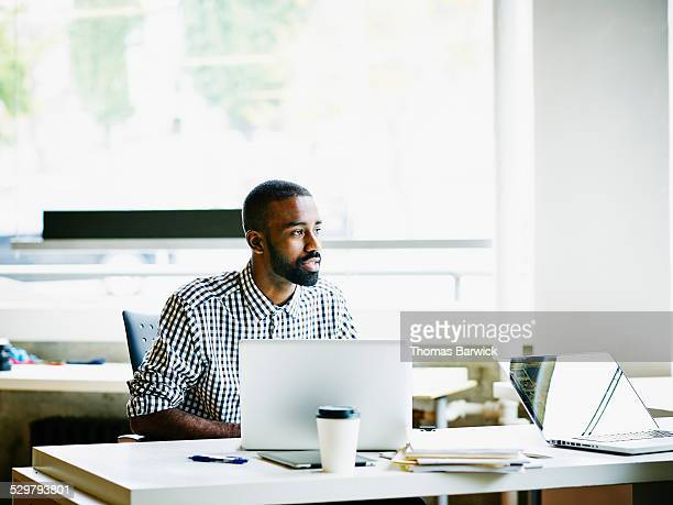 Businessman working on laptop at workstation