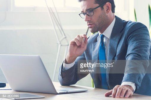 Businessman working on laptop computer.