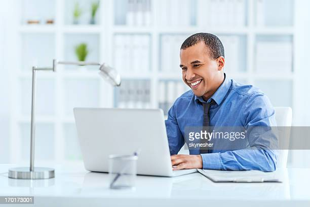 Businessman working on laptop in his office.