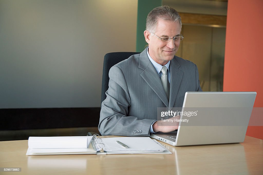 Businessman working on laptop : Bildbanksbilder