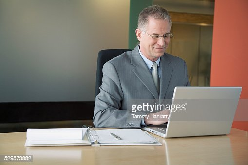 Businessman working on laptop : Stock Photo