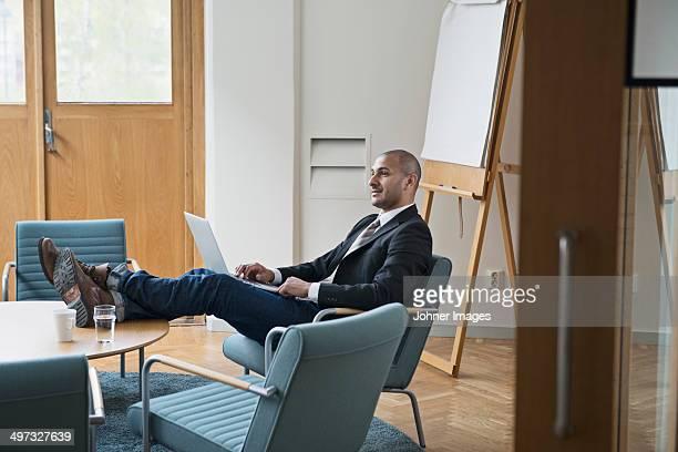 Businessman working on laptop, Stockholm, Sweden