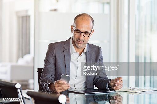 Businessman working on phone : Stock Photo