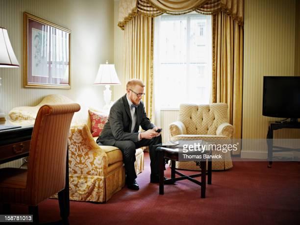 Businessman working on smartphone in hotel